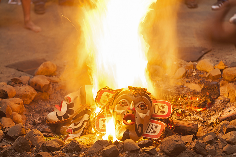 After completion of the Forest Dance, Beau Dick burns masks he carved in the central fire of the Bighouse, a decision not favored by everyone involved with protocol and procedures for the potlatch.